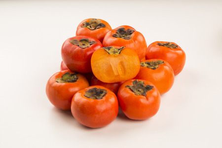 khaki: Some khaki fruits on white background. Fresh fruits. Stock Photo