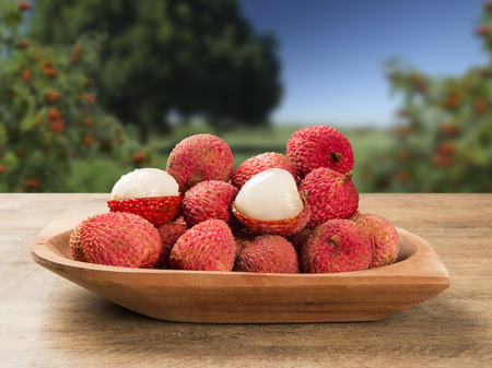 leechee: fresh lychees on wooden surface. Fresh fruits