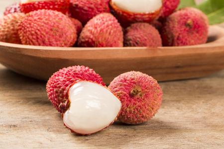 lichi: fresh lychees on wooden surface. Fresh fruits