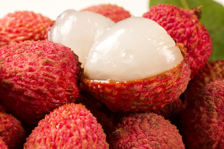 leechee: fresh lychees on wooden surface. Fresh fruits