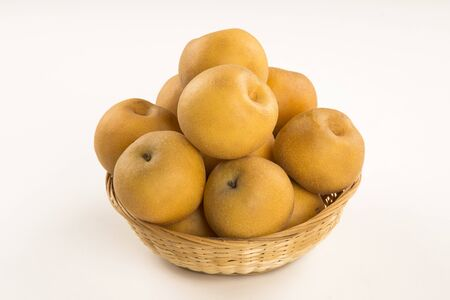 Some asian pears over a white background.