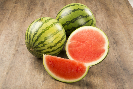 slices of watermelon on wooden table. Stock Photo