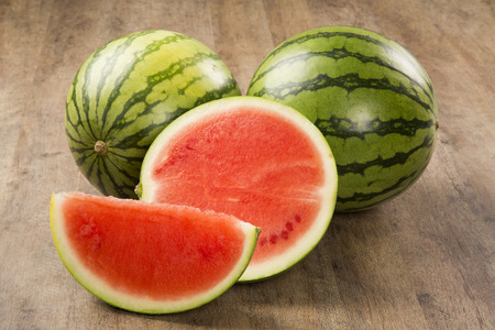 seedless: slices of watermelon on wooden table. Stock Photo