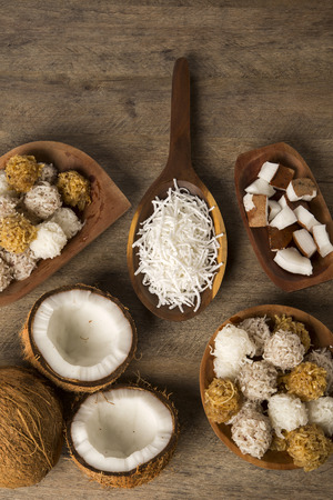 colombian food: Peruvian cocadas, a traditional coconut dessert sold usually on the streets, made of grated coconut and white or brown sugar (Selective Focus, Focus on the front of the cocadas) Stock Photo