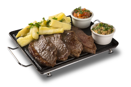 portion: picanha portion and manioc fries. Stock Photo