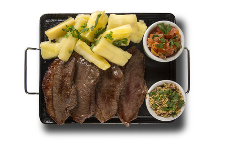 a portion: picanha portion and manioc fries. Stock Photo