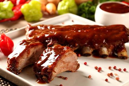 delicious roast pork rib won white dish. Barbecue cream.