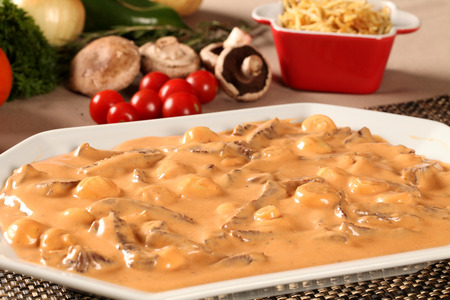 strogonoff with fries, rice and vegetables background