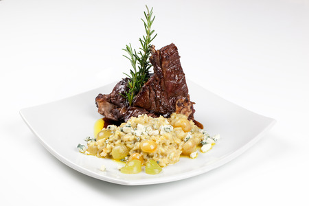 Roasted Lamb Chops with Risotto and Vegetables. Garnished with Sauce Stok Fotoğraf - 56855109