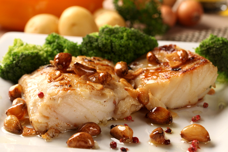 Codfish - fish fillet in sauce and vegetables