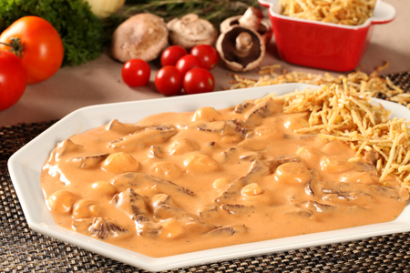 ailment: strogonoff with fries, rice and vegetables background