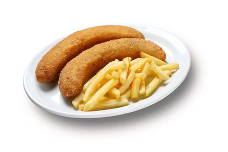 platanos fritos: pl�tanos fritos calientes en la placa con la patata frita.