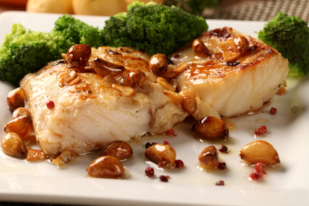 codfish: Codfish - fish fillet in sauce and vegetables