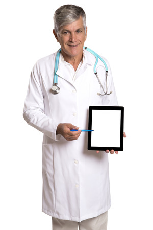 patient notes: Doctor checking patient notes on a tablet-pc standing with his stethoscope around his neck reading the information on the screen, isolated on white