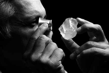 jeweler: portrait of a jeweler during the evaluation of Gemstone Stock Photo