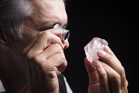 portrait of a jeweler during the evaluation of Gemstone Stock Photo