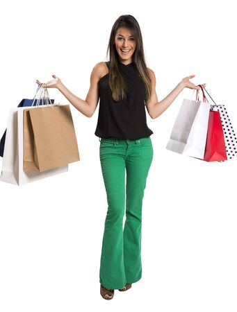 happy cute young woman shopping with color bags - isolated on white background
