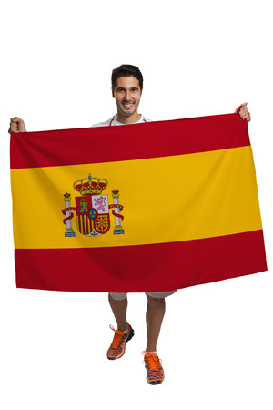 nationalistic: Fan holding the flag of spain celebrates on white background Stock Photo