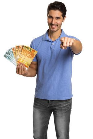A businessman showing brazilian money. Brazilian real money.