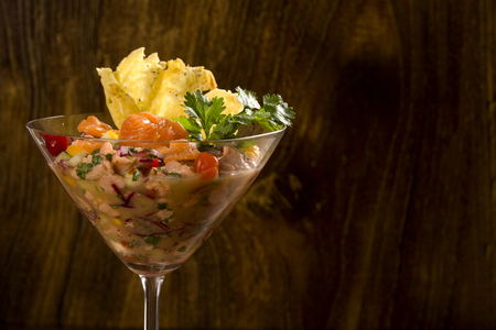 mixed fish Ceviche with salmon, onion and pepper. Stock Photo