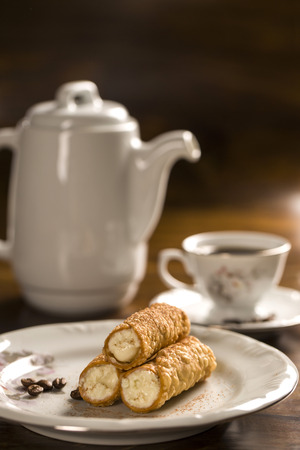 cannoli pastry: typical Sicilian pastries called CANNOLI with amarena listed in pastry on the plate. Stock Photo