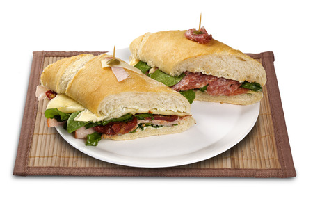 crusty french bread: Natural fresh baguette sandwich with salad. White background. Stock Photo