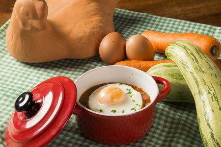 poached: Poached eggs in tomato sauce on wooden background