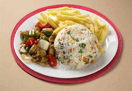 rice plate: Chicken chow mein a popular oriental dish available at chinese take outs. Chinese food. Stock Photo