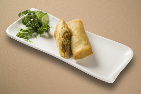 Spring Rolls - Fried vegetable spring rolls served with sweet chili sauce. Close up. Stock Photo