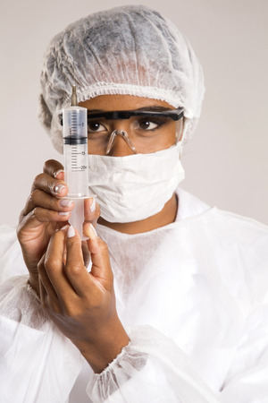Female medical professional researcher scientist holding a syringe injection jab vaccination cure discovery