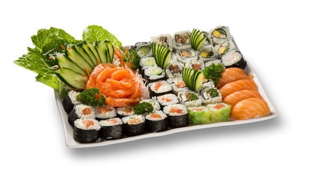 japanese seafood sushi and maki on white plate