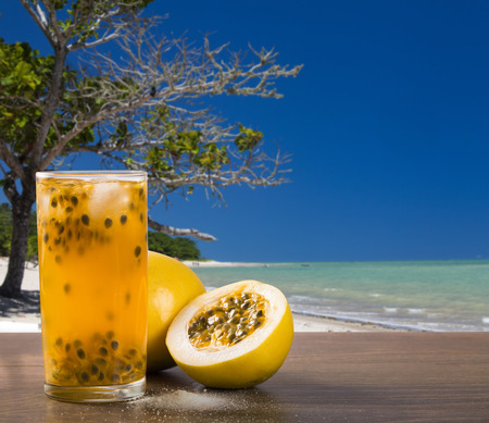 caipirinha: Fresh drink made with passion fruit Caipirinha in the beach background