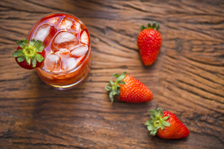 caipirinha: Fresh made Strawberry Caipirinha on wooden background Stock Photo