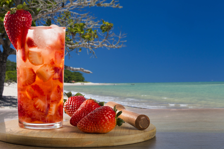 caipirinha: Fresh drink made Strawberry Caipirinha in the beach background
