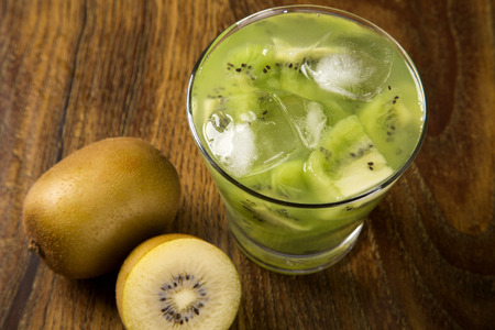 caipirinha: Kiwi Fruit Caipirinha of Brazil on wooden background