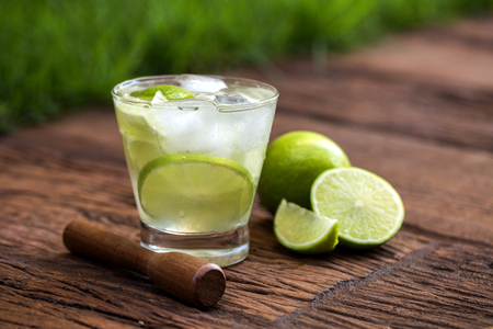 caipirinha: Lemon Fruit Caipirinha of Brazil on wooden background
