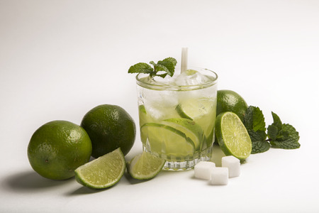 caipirinha: Caipirinha - brazilians national cocktail made with cachaca, sugar and lemon or lime, isolated on white background Stock Photo