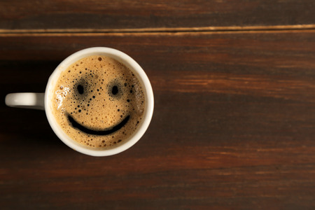 Good morning coffee smile cup on wooden background Stock Photo