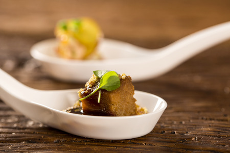 Pork tongue, ground banana, Marsala reduction, water meal and watercress in a spoon. Taste gastronomy fingerfood