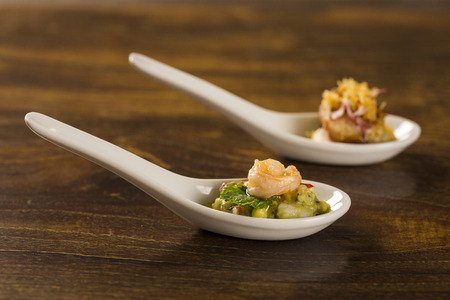 Shrimp Salad With Avocado in a spoon. Taste gastronomy finger food
