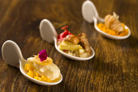 Entry, entree and dessert of finger food in a spoon. Taste gastronomy finger food Stock Photo