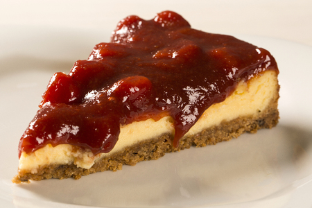 Cheesecake with brazilian goiabada jam of guava on plate on table Stock Photo