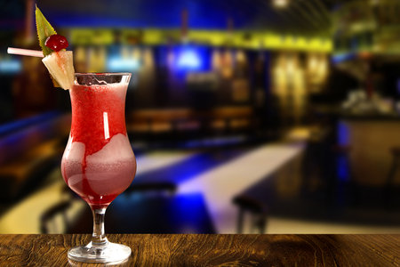 Cocktail on blurry pub background