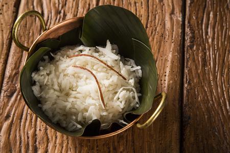 Rice with coconut in an old copper pot - Traditional bahia food