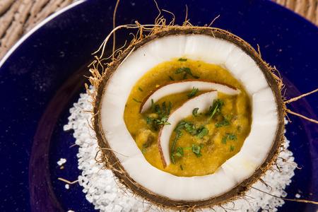 Sururu soup inside a coconut. Brazilian dish.