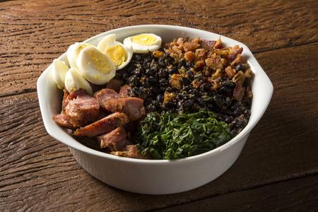 Tropeiro bean. Traditional brazilian food. Stock Photo