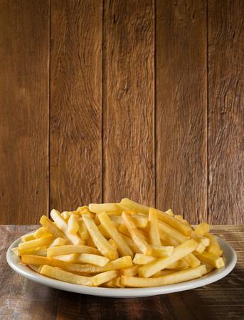 french fries on dish. Reklamní fotografie