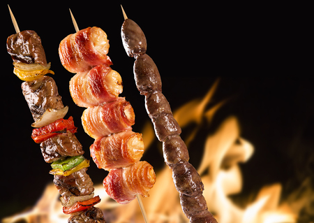 grill: Assorted steak skewers on a fire background