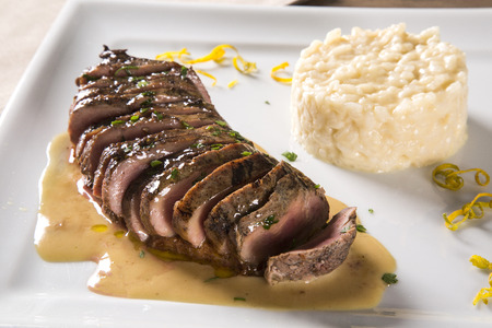 Duck magret with tucupi sauce and jambu risotto.
