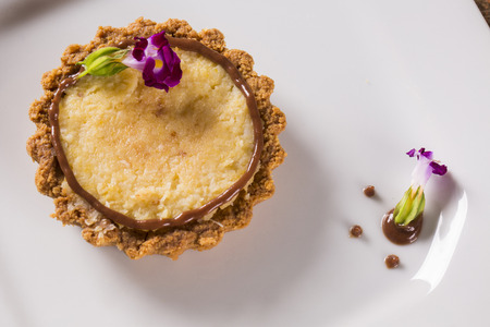 corn cheese cake with hazelnut cream in a white plate.